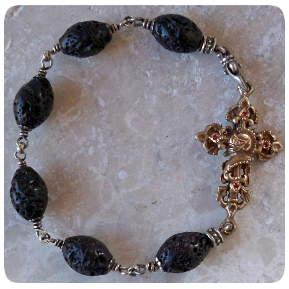 gothic jewelry necklaces, pendants, crosses, bracelets, skull rings, earnings with diamonds and rubies