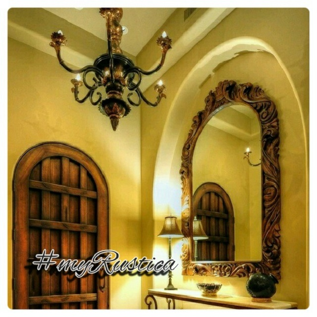 handmade illumination fixtures for rustic home improvement including forged iron hacienda chandeliers, punched tin lamps and shades, hanging glass lights, and outdoor wall lanterns